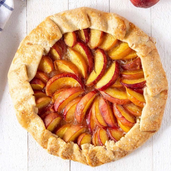 baked peach galette on a board