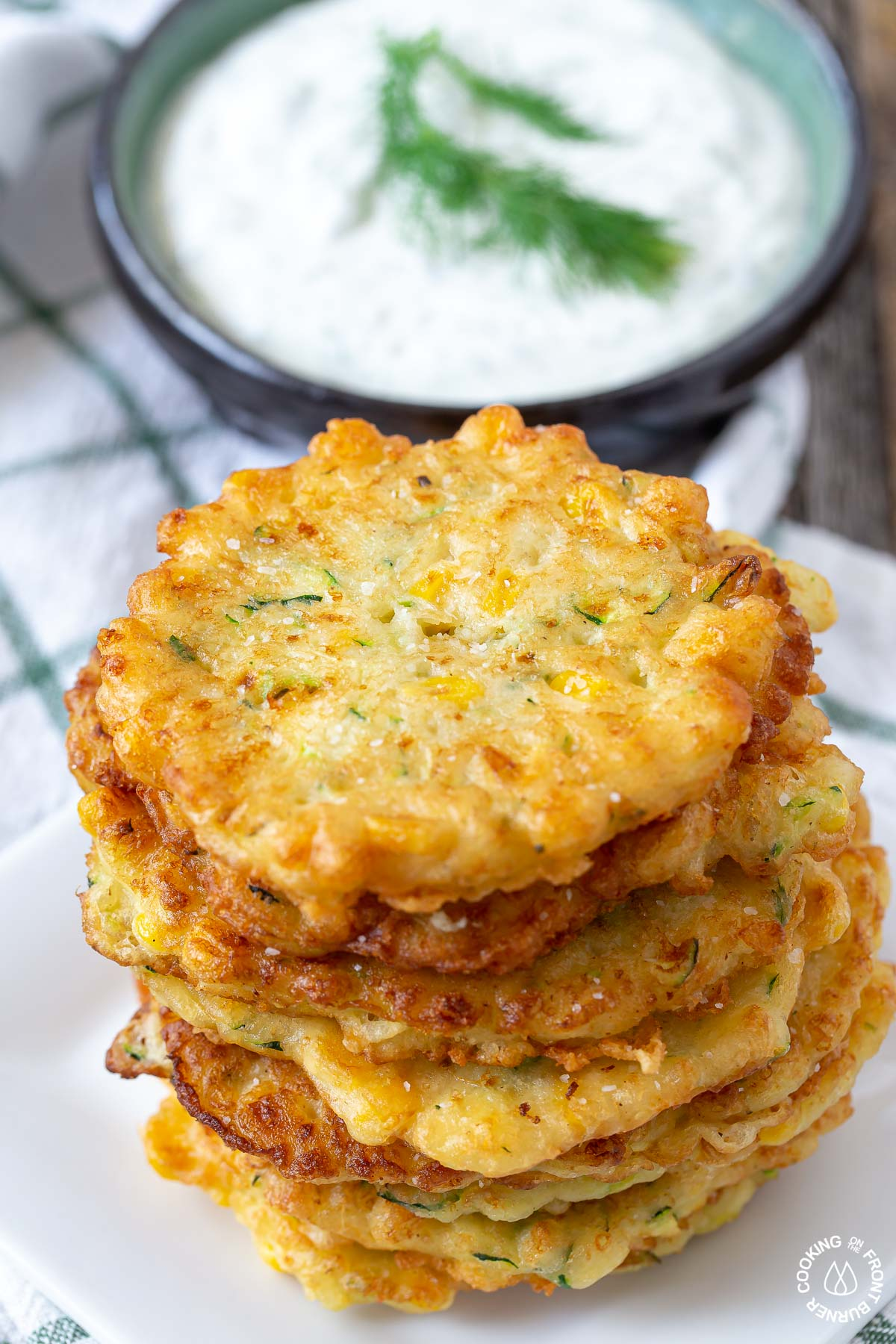 a stack of fried zucchini corn fritters on a plate