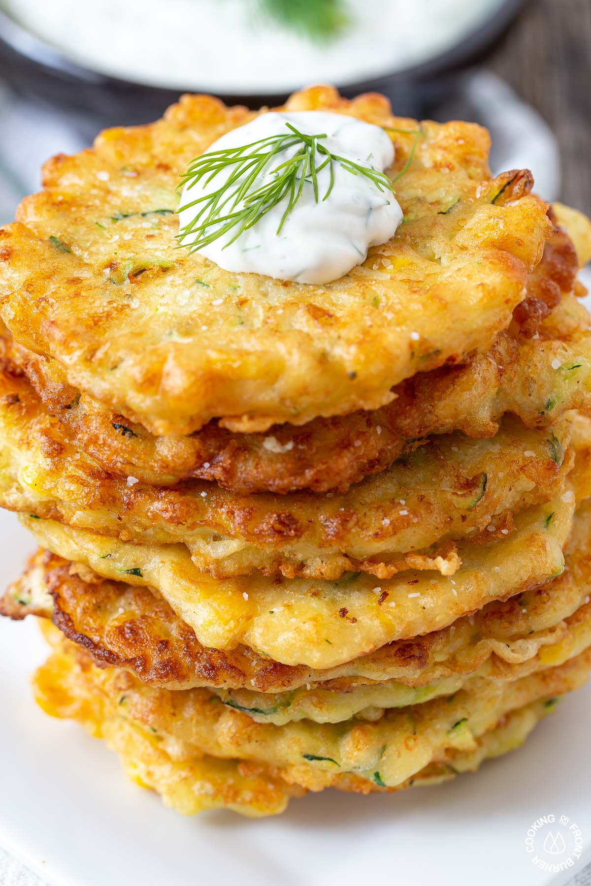stack of zucchini corn fritters on a plate