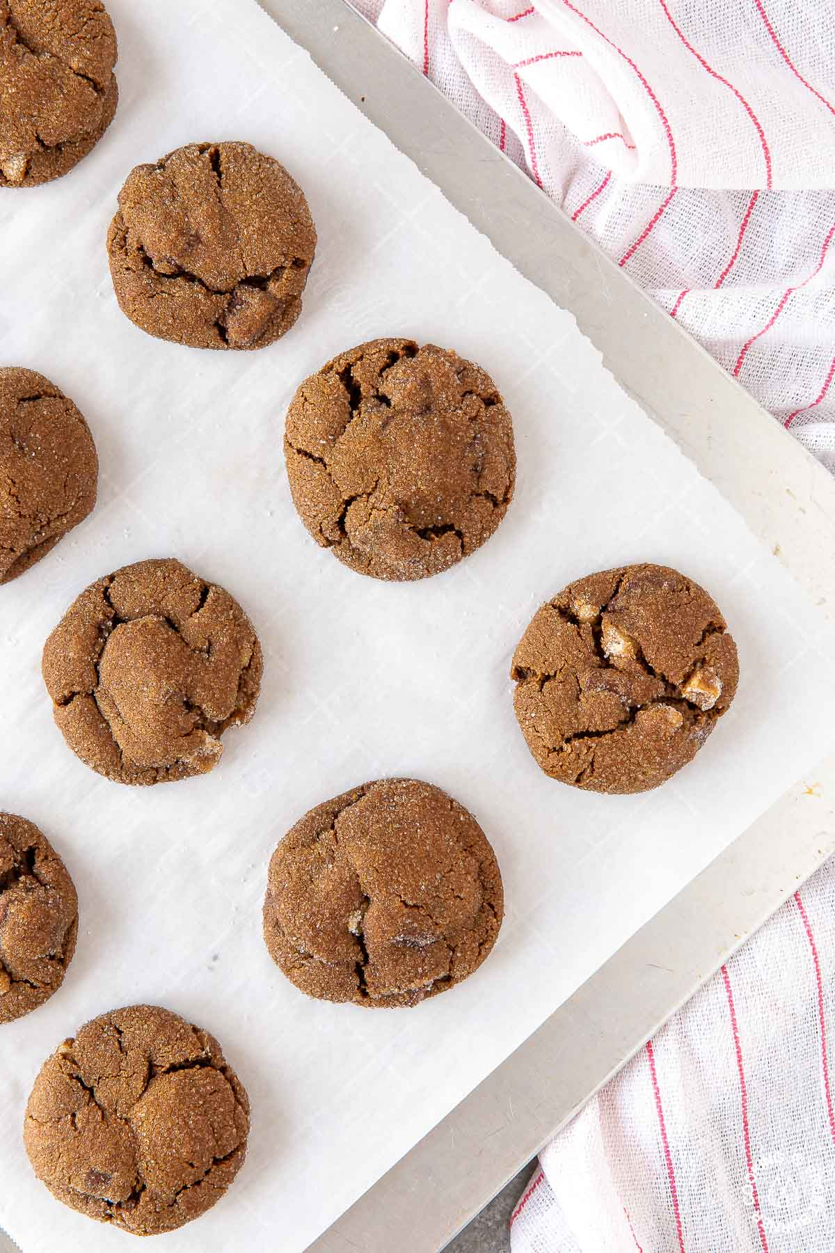 a cookie sheet with baked triple ginger chocolate cookies