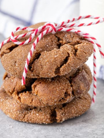 3 triple ginger cookies stacked and tied with a red cord