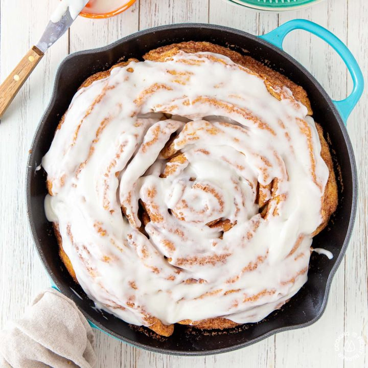 giant cinnamon roll in a skillet