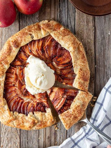 apple galette on a board with ice cream on top