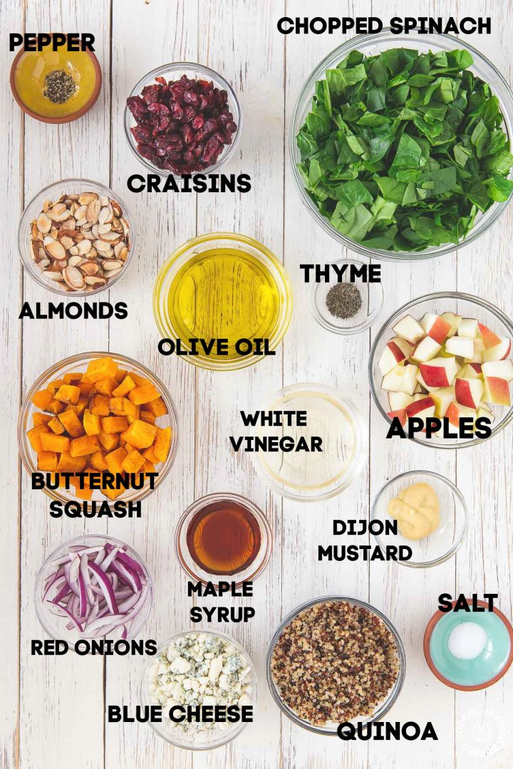 ingredients for fall chopped salad in bowls on a board