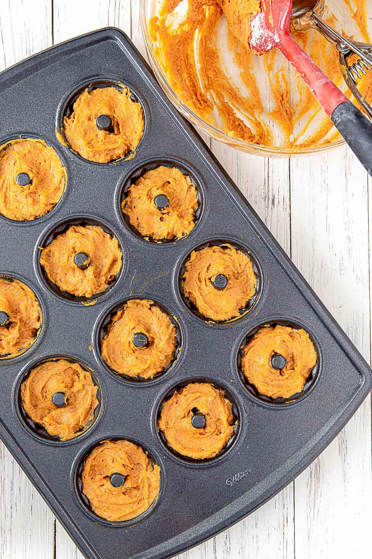 pumpkin batter in mini bundt cake pan