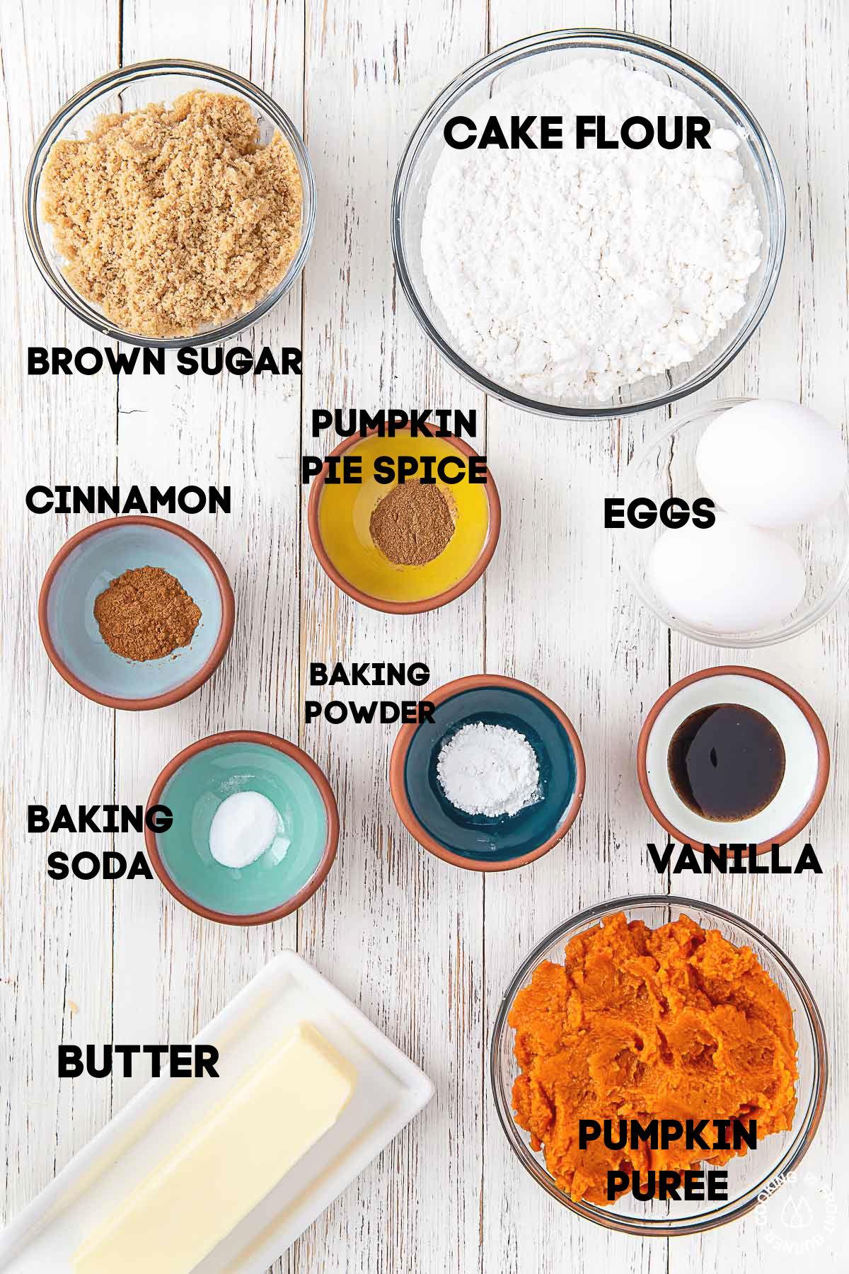cake flour, brown sugar, eggs, cinnamon, pumpkin pie spice, baking soda, baking powder pumpkin puree butter in bowls