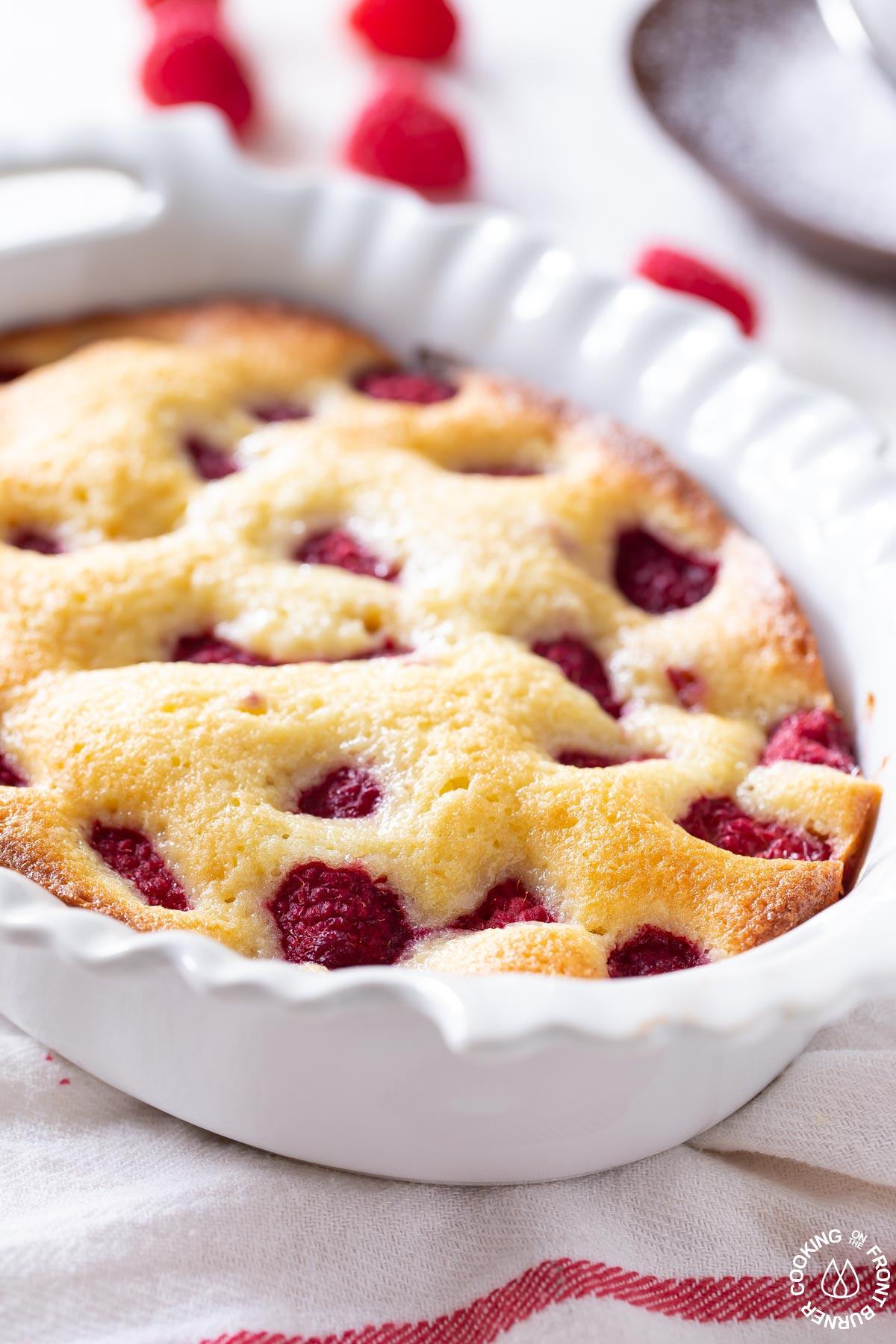 baked lemon raspberry buckle cake in a white baking dish