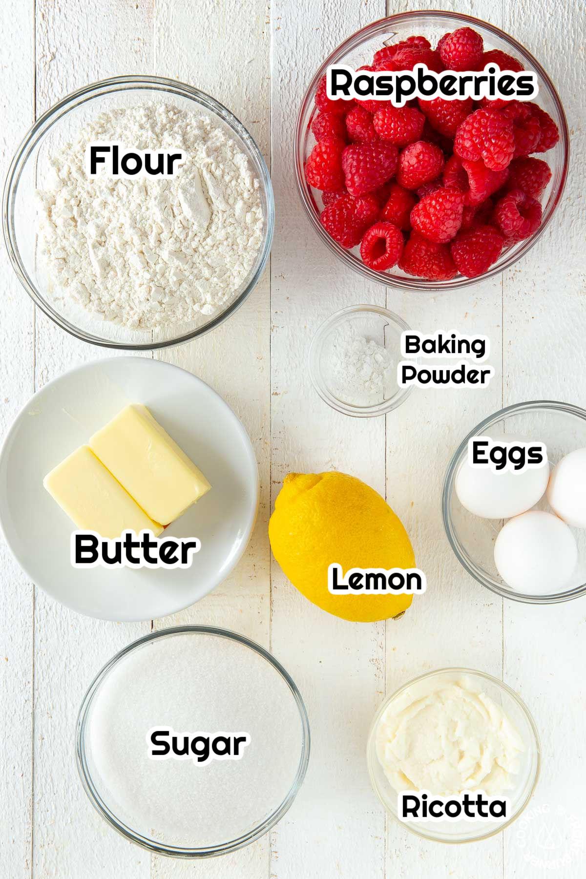 flour, sugar, butter, lemon, baking powder, raspberries, eggs in a bowl