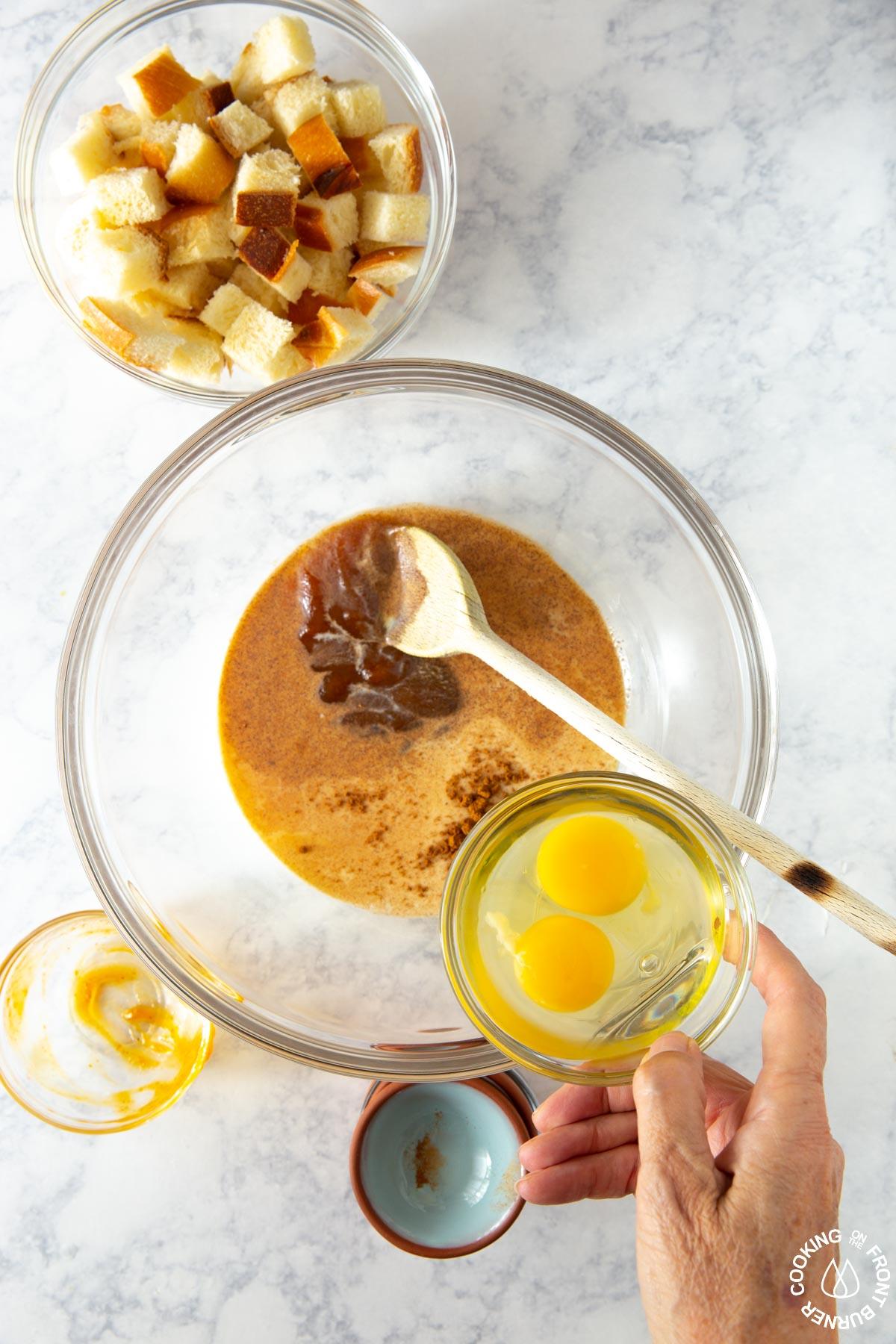 adding eggs to a pumpkin milk mixture