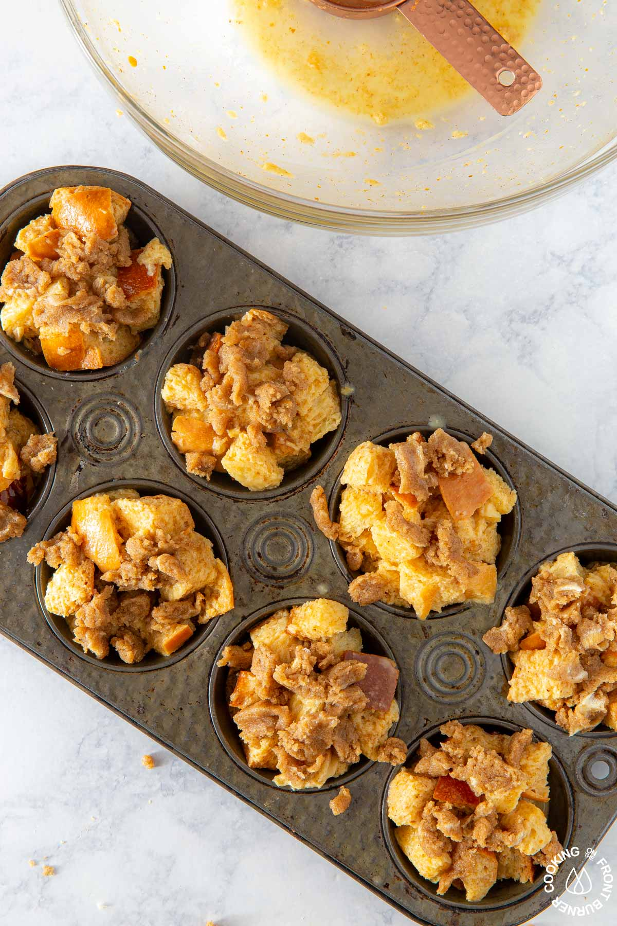pumpkin butter french toast cubes in a muffin pan